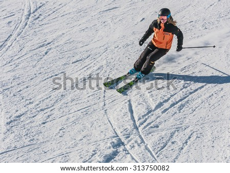 LIVIGNO, ITALY - JANUARY 28, 2015: Skier on the slope of  Ski resort Livigno, Lombardi, January 28, 2015, Italy. Livigno is  developing ski resort in northern Italy - stock photo