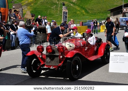 LIVIGNO, ITALY - JUNE 13: A red Alfa Romeo 6C 1500 Gran Sport starts the Summer Marathon classic car race on June 13, 2014 in Livigno. This car was built in 1930 - stock photo