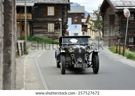 LIVIGNO (SO), ITALY - JUNE 15: A black Riley Alpine Trial Six takes part to the Summer Marathon classic car race on June 15, 2014 in Livigno (SO). This car was built in 1934 - stock photo