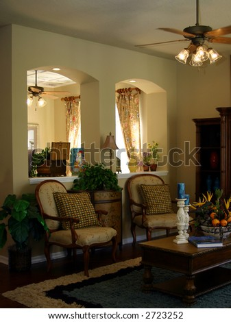 living area in upscale home with arched room dividers - stock photo