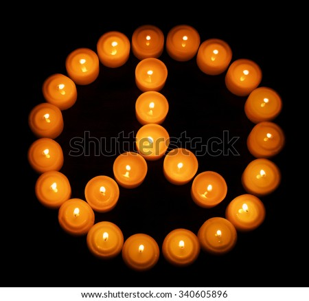 Living at peace - peace symbol made of tea lights - stock photo