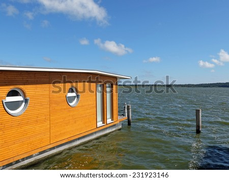 Living at the Lake - Houseboat on the water - stock photo