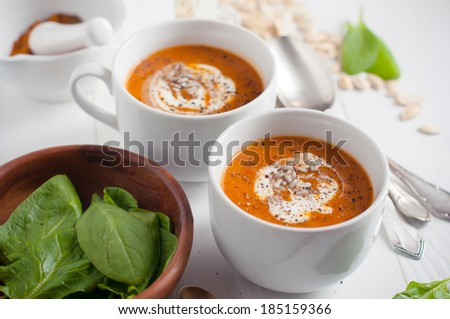 Living healthy food: pumpkin soup with cream and herbs. Vegetarian lunch, rustic dinner. - stock photo