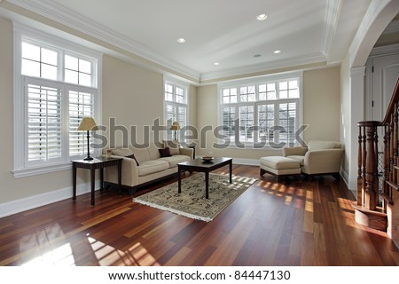 Living room in luxury home with cherry wood flooring