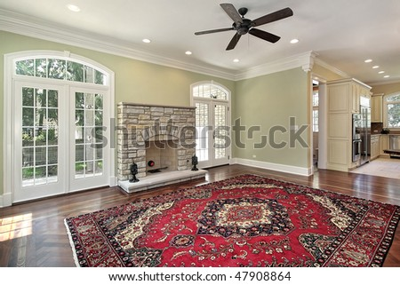 Living room in new construction home with stone fireplace - stock photo