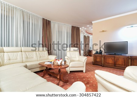 Living room interior in the evening - stock photo