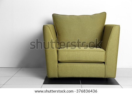 Living room interior with green armchair on white wall background - stock photo