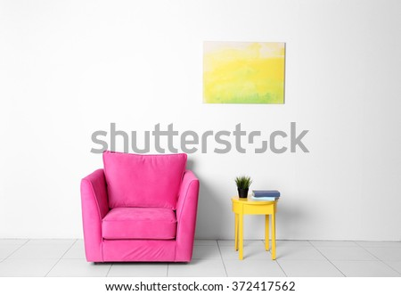 Living room interior with pink armchair and yellow chair on white wall background - stock photo
