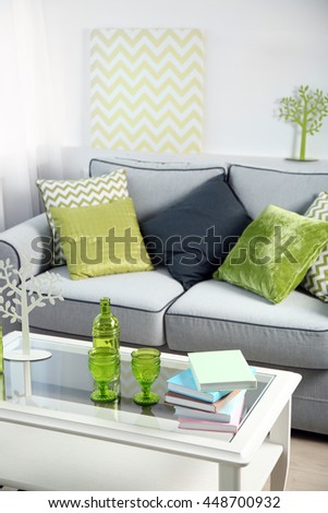 Living room interior with sofa and table - stock photo