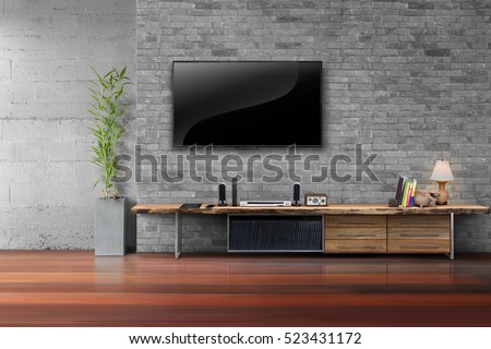 Living room led tv on brick wall with wooden table and plant in pot empty interior