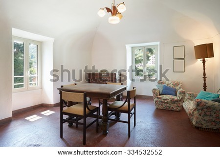 Living room, old interior with table, four chairs and two windows - stock photo