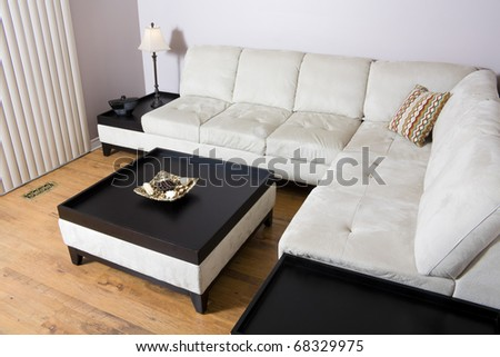 living room setting with sectional couch and coffee table