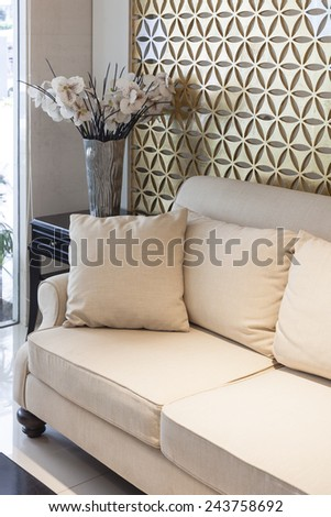 Living room sofa modern style Interior with pillows and flower - stock photo