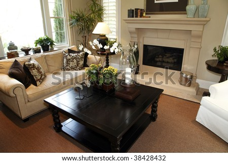 Living room with a fireplace and stylish decor. - stock photo