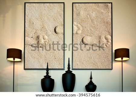 living room with big pictures on the wall. Footprints on sea shore Photos in Interior design - stock photo