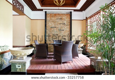 Living room with cane chairs and table - stock photo
