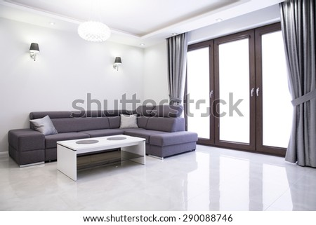 Living room with elegant sofa in modern house - stock photo