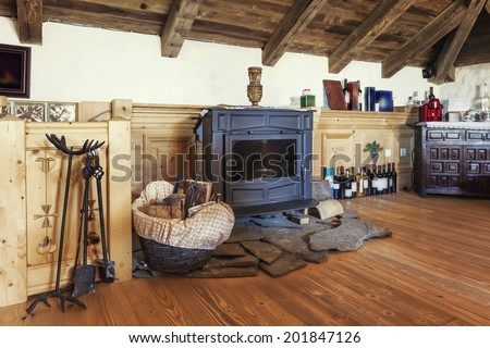 Living room with fireplace in old-fashion wooden style - stock photo