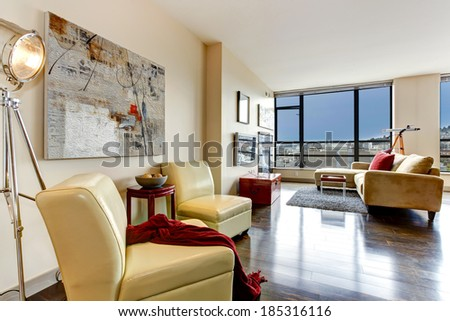 Living room with glass wall. Furnished with yellow chairs
