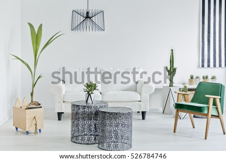 Living room with green armchair, openwork table and sofa
