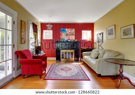 Living room red yellow walls fireplace stock photo for Red and yellow living room ideas