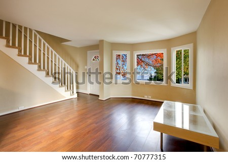 Living room with staircase and nice cherry floor - stock photo