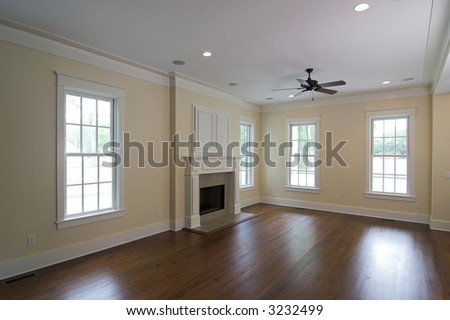 livingroom in affluent home with fireplace - stock photo