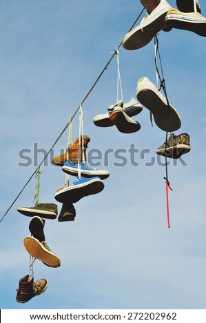 Ljubljana, Slovenia. A decoration in Metelkova district - shoes hanging on a rope. Taken on 2014/07/10
