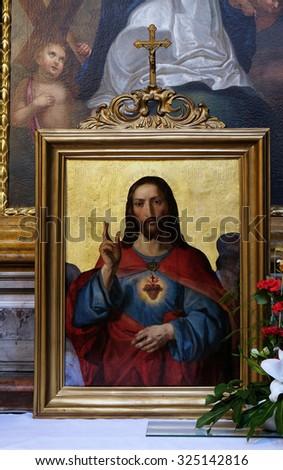 LJUBLJANA, SLOVENIA - JUNE 30: Sacred heart of Jesus, painting in the St Nicholas Cathedral in Ljubljana, Slovenia on June 30, 2015 - stock photo