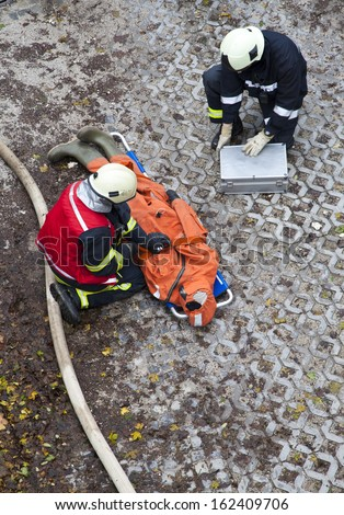 Ljubljana, Slovenia, 10.11.2013, The rescue workers and firefighters move hurt person with a stretcher, during  a training exercise  - stock photo