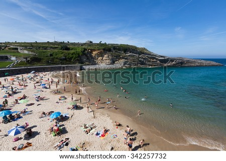 LLANES, SPAIN - JULY 3, 2015: Beach of Llanes in summer. Spain