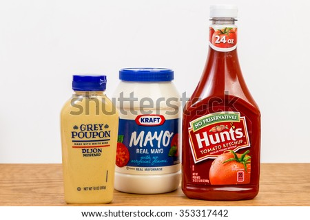 LLANO, TX-DEC 19, 2015: Ketchup, Mustard and Mayonnaise; on kitchen counter with white background and copy space - Hunt's Ketchup; Kraft Mayo and Grey Poupon Dijon Mustard. - stock photo