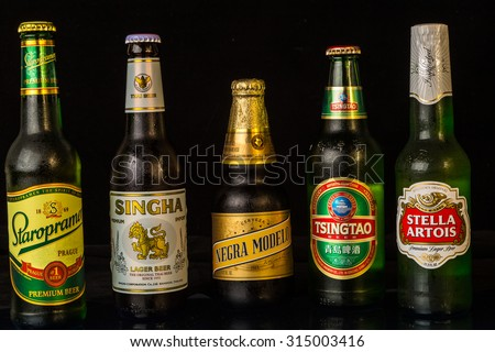 LLANO, TX-SEP 9, 2015:  Five beers from different areas of the world; Staropramen; Singha; Negra Modelo; Tsingtao; Stella Artois.  Czech Republic; Thailand; Mexico; China; Belgium. - stock photo