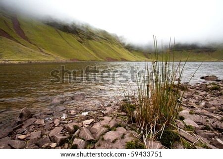 Llyn y Fan Fach (Welsh meaning Lake of the small beacon-hill), Brecon Beacons National park in Wales, UK - stock photo