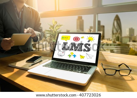 LMS Thoughtful male person looking to the digital tablet screen, laptop screen,Silhouette and filter sun - stock photo