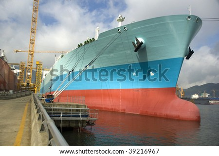 LNG carrier ship designed for transporting natural gas anchored - stock photo