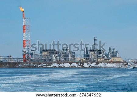 "LNG plant ""Prigorodnoe"", Aniva bay, Sakhalin, Russia - stock photo"