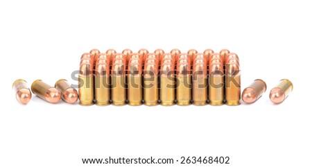 Loaded cartridges. 45 ACP cartridges on white background - stock photo