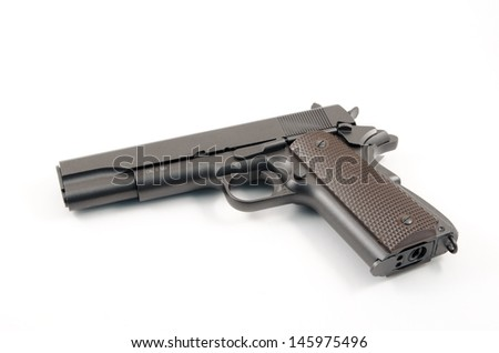 Loaded hand gun against white background of the 1911 variety - stock photo
