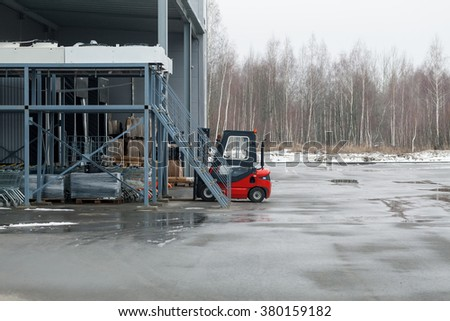 loader in a warehouse hypermarket - stock photo