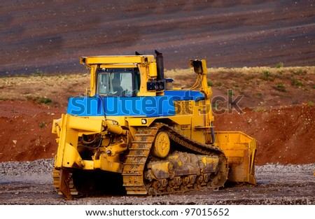 loader with caterpillar - stock photo