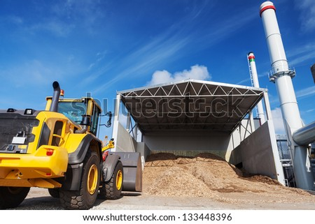 Loader works at bio fuel power co generation station - stock photo