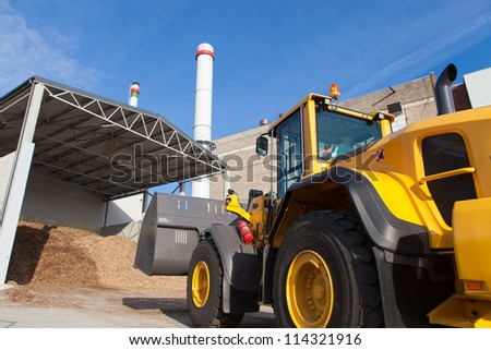 Loader works at bio fuel power station - stock photo