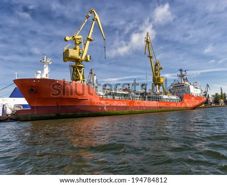 loading a ship in the Port of Gdansk, Poland - stock photo