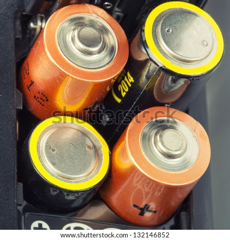 Loading batteries into a electronic device - stock photo