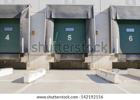 Loading bay for trucks with numbers - stock photo