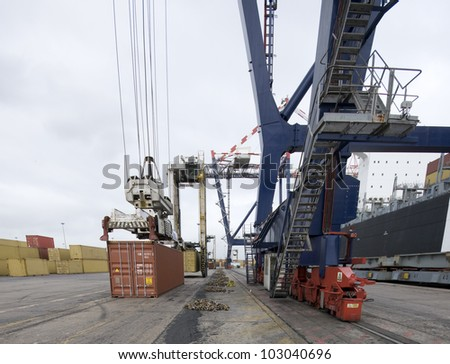 loading containers by shore crane - stock photo