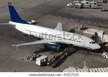 Loading freight cargo onto aircraft - stock photo
