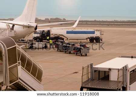 Loading fuel and Luggage at Airport - stock photo