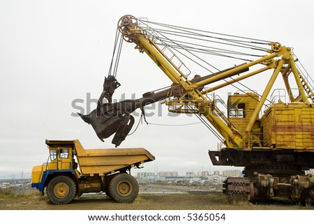 Loading in a body of 40-ton truck. - stock photo